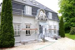 arbejder med facade renovering
